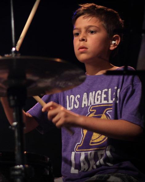 Kid performing on the drums