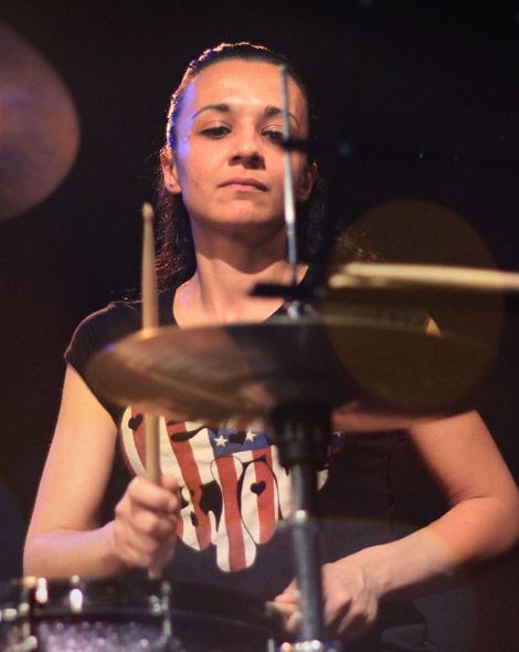 Woman playing drums on Skype